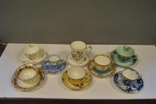 Eight hand painted bone china English cups and saucers