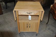 Blonde wood roll around drop leaf kitchen cart