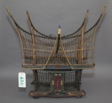 Asian birdcage, polychrome decorated carved wood ship form.