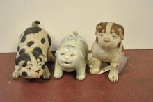 Three Asian dog figurines, two wood by Naito Koseke and one porcelain