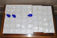 Approximately 400 crystal prisms, cobalt blue in three sizes and clear, all new,