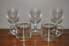 23 crystal white wine goblets and 11 glass coffee mugs