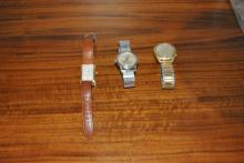 Trio of men's watches: 14k Bulova with gold filled case, Gruen with gold plated back and leather strap, stainless steel 17 jewel Bul..