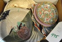 Collection of assorted Asian serving dishes and plates