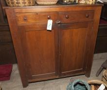 Antique American jelly cupboard with two short drawers over a pair of panel doors