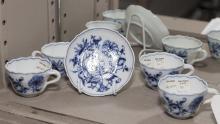 Five pieces German BLUE ONION porcelain; Meissen saucer and four Meissen style demitasse cups