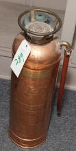 Antique Red Star copper fire extinguisher with embossed label