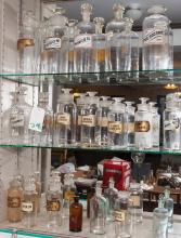 19th Century, unique collection of nineteen antique glass apothecary jars, most have their original blown glass reverse painted and ...