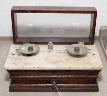 Antique Henry Troemner table top pharmacy scale with three weights on marble with hinged lid