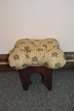 Small stool with designer buttoned upholstery with elephant figural decoration