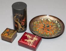 Four pieces: two Asian lacquer boxes, an enamel plate signed D. Farley, and a gilt decorated tin cannister.
