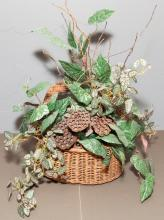 Vintage fishing basket with artificial flowers