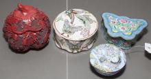 Four Asian design covered boxes