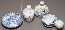 Two small Asian design bottles with stoppers, small bowl stamped E