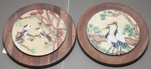 Pair of solid walnut wall plaques with circular porcelain plates featuring Asian birds and budding floral trees - diameter: 8 inches