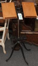 Late 19th century book stand, on cast iron base with revolving two-piece oak book rests.