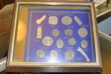 Collection of authentic replicas of ancient coins in shadow box