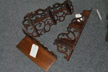 Three pieces: wooden wall shelf with pierced back along with a pair of three tiered corner wall hangings