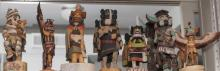 Collection of seven Kachina dolls including Zuni Rain Forest, clown Kachina, and Eagle Kachina