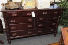 Dresser with mahogany finish, carved rose handles, and four short drawers over six long drawers - height: 37