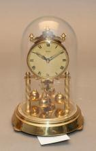 A German Hermle glass domed clock