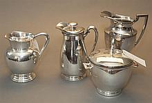 Four American plated silver articles, jugs, pitchers and lidded ice bucket