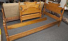 Pair of matching twin beds, maple colored wood, with side rails and slat boards
