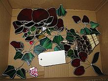 Collection of stained glass window decorations featuring fruit