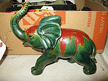 Glazed pottery elephant with iridescent finish