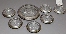 Seven-piece Frank M. Whiting sterling silver mounted glass coaster set; one for wine and six for goblets.