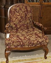 Queen Anne style armchair with floral upholstery.