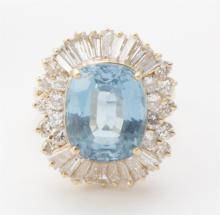 Topaz, diamond, and gold cocktail ring
