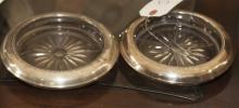 Pair of sterling and crystal 1948 wine coasters
