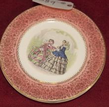Pair of decorative porcelain plates depicting figural scenes