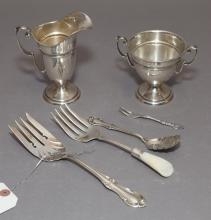 Collection of silver items, including: International sterling creamer and sugar bowl, four serving utensils including one Internatio...