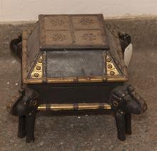 Decorative wooden stool with hinged top and elephant form feet