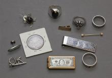 Collection of silver and gold tone jewelry and miscellaneous pieces including 1893 Columbian half dollar, two money clips, four ring...