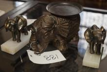 Pair of brass elephant form bookends together with an elephant form stand