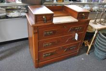 Victorian dresser having inset marble top, five drawers, and original pulls