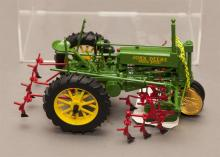 Cast metal John Deere Model A toy tractor with original paint and decals
