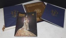 Assortment of Veiled Prophet items including waste basket, leather binder, placemats, and