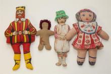 Four vintage stuffed printed fabric dolls