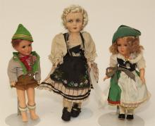 Three European dolls in Regional costumes, hard plastic and one painted silk over molded mask face on cloth body