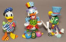 Collection of three Walt Disney figures by Romero Brittto, Jiminy Cricket, Donald Duck and Uncle Scrooge