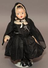 13 1/2 All-composition doll as NUN with molded hair with bow, painted eyes to side, closed mouth, wearing sterling silver cross