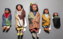 Seven SKOOKUM dolls, composition and cloth, heights 3 to 12 inches