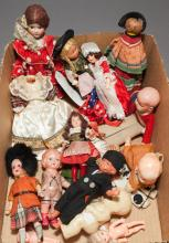 Twelve small dolls including 7