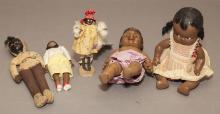 Five black dolls including five-piece composition baby