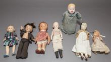 Seven vintage dolls; most all composition with molded hair, 11 3/4