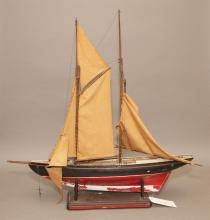 Model sail boat on stand
